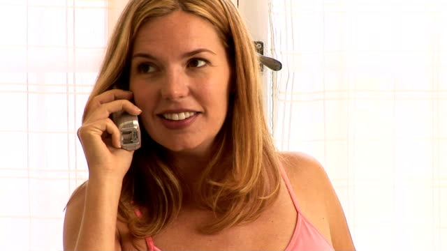 pregnant woman on the phone - see other clips from this shoot 1107 stock videos and b-roll footage