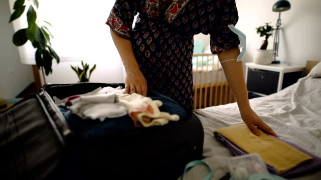 pregnant woman packing stuff for maternity hospital - pregnant stock videos & royalty-free footage