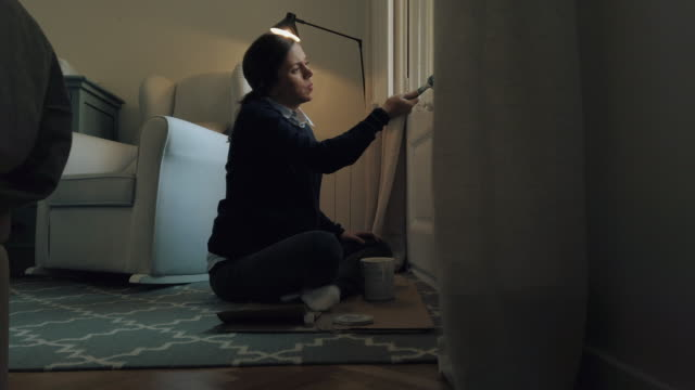 pregnant woman painting windows in white - nursery bedroom stock videos & royalty-free footage