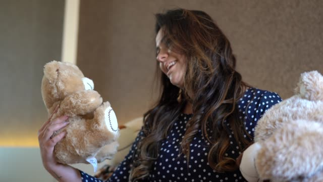 pregnant woman playing with teddy bear at home - pardo brazilian stock videos & royalty-free footage
