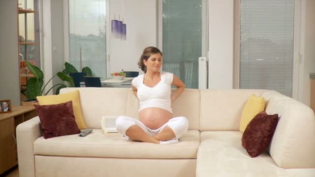 hd dolly: pregnant woman reading - tidy room stock videos & royalty-free footage