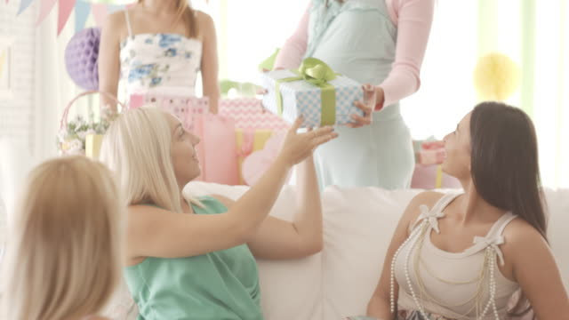 pregnant woman receiving gifts at baby shower - baby shower stock videos and b-roll footage