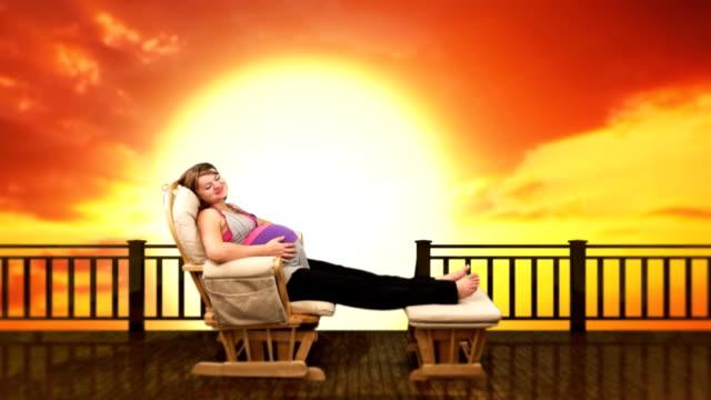 vídeos y material grabado en eventos de stock de a pregnant woman relaxes in a glider against a computer generated blazing sunset - balancearse