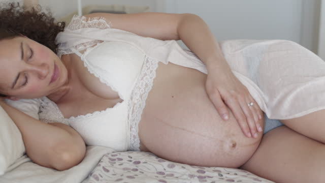 pregnant woman relaxing at home - bed furniture stock videos & royalty-free footage