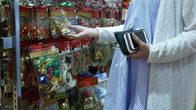 pregnant woman shopping christmas ornament - christmas decoration stock videos and b-roll footage