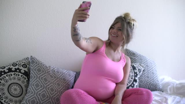 WS Pregnant woman taking a selfie