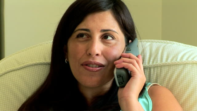 pregnant woman talking on the phone - schnurloses telefon stock-videos und b-roll-filmmaterial