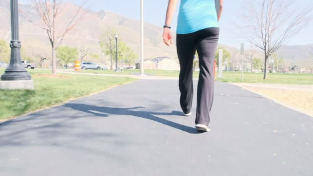 pregnant woman walking in the park - relaxation exercise stock videos and b-roll footage