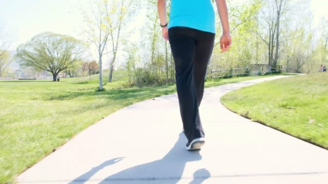 pregnant woman walking in the park - relaxation exercise stock videos & royalty-free footage