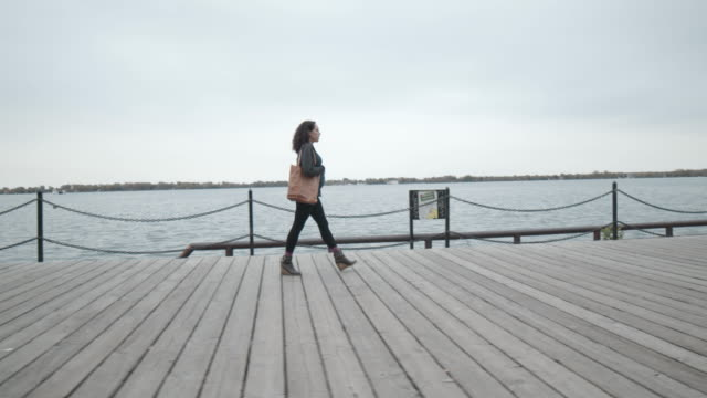 pregnant woman walking on lakefront boardwalk - waterfront stock videos & royalty-free footage