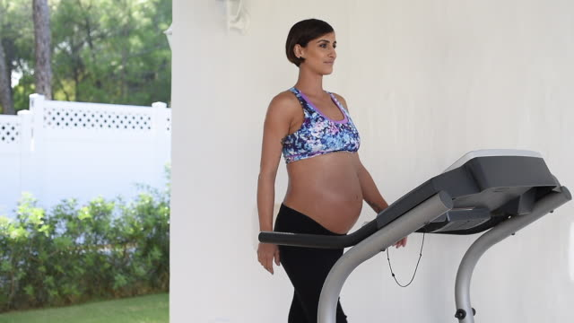 pregnant woman walks on a treadmill - prenatal care stock videos & royalty-free footage