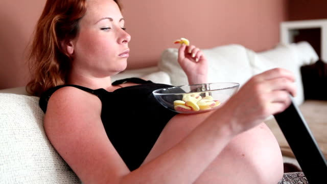 pregnant woman watching tv - hungry stock videos and b-roll footage
