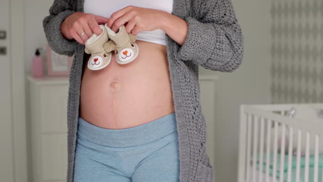 Pregnant woman with baby booties/ Debica/ Poland