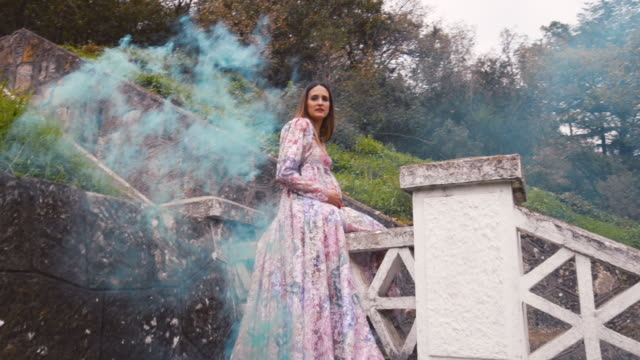 pregnant woman with fancy dress and colored smoke - prenatal care stock videos & royalty-free footage
