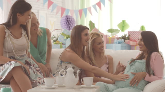 pregnant woman with friends on baby shower party - baby shower video stock e b–roll