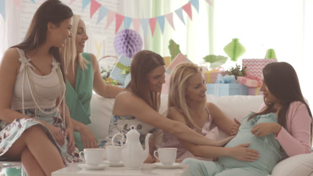 pregnant woman with friends on baby shower party - baby shower stock videos and b-roll footage