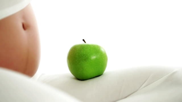 pregnant woman with green apple - navel stock videos & royalty-free footage