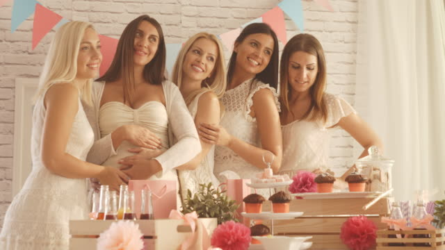 pregnant woman with her female friends - baby shower video stock e b–roll