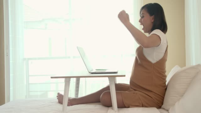 pregnant woman working and success in bed room slow motion - labor childbirth stock videos and b-roll footage