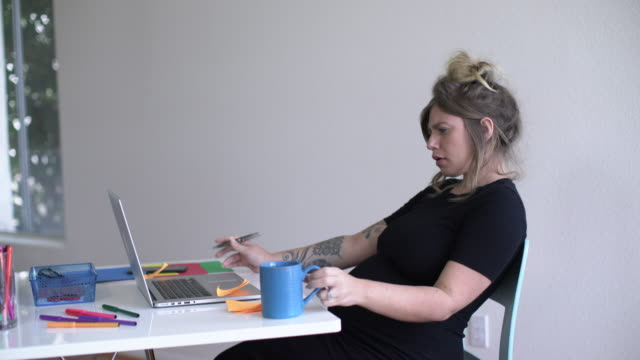 MS Pregnant woman working in the creative industry