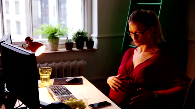 pregnant woman working late again - employment and labor stock videos and b-roll footage
