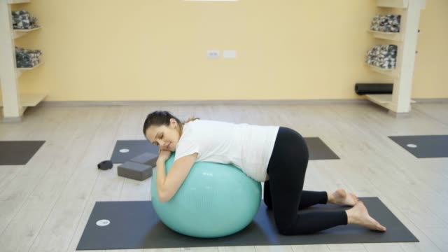 pregnant women exercise yoga - prenatal care stock videos & royalty-free footage