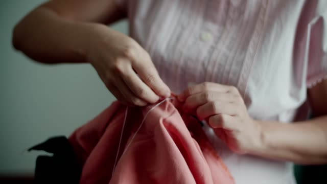pregnant women with needle sewing patchwork - embroidery stock videos & royalty-free footage