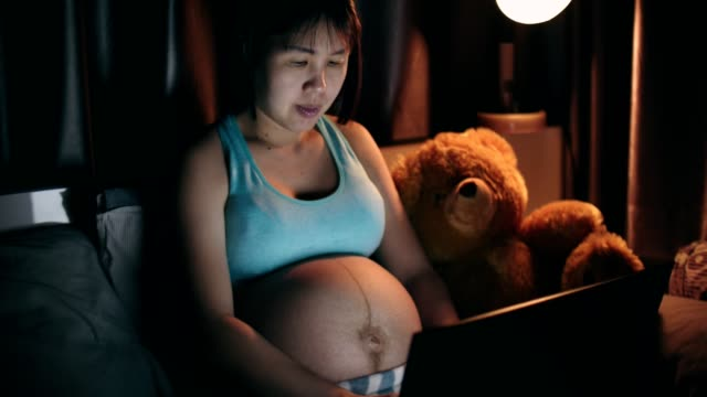 pregnant women working at night - chinese ethnicity stock videos & royalty-free footage