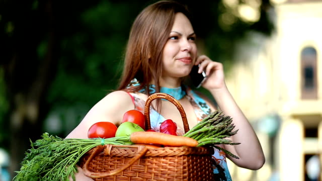 Pregnant Young Brunette Woman Holding Basket Full Of Veggies