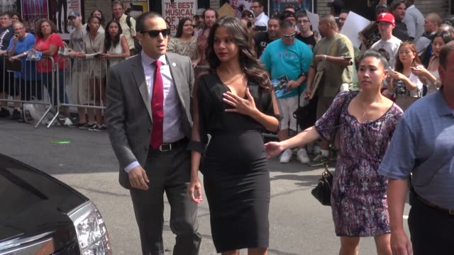 pregnant zoe saldana walking into the late show with david letterman - celebrity sightings in new york on july 30, 2014 in new york city. - talk show stock videos & royalty-free footage