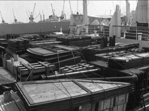 prehab huts being sent for victims of skopje earthquake; england: tilbury: ext gv prefab huts tied up and in piles more gv more - shack stock videos & royalty-free footage