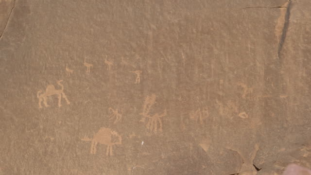 prehistoric inscriptions and carvings in wadi rum desert, jordan - engraved image stock videos and b-roll footage