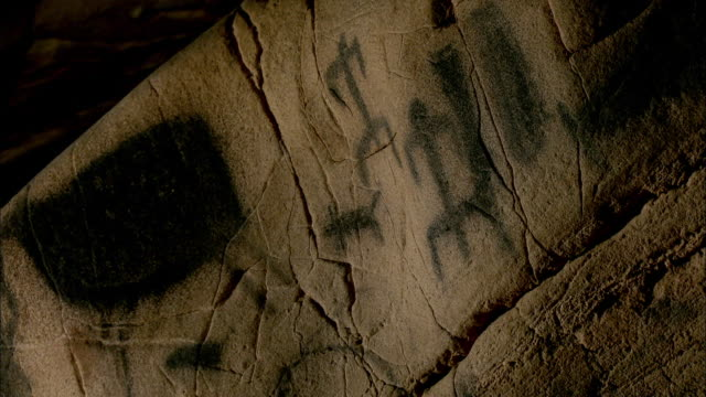 prehistoric mural inside a cave in levanzo island, west of sicily, italy - 壁画点の映像素材/bロール