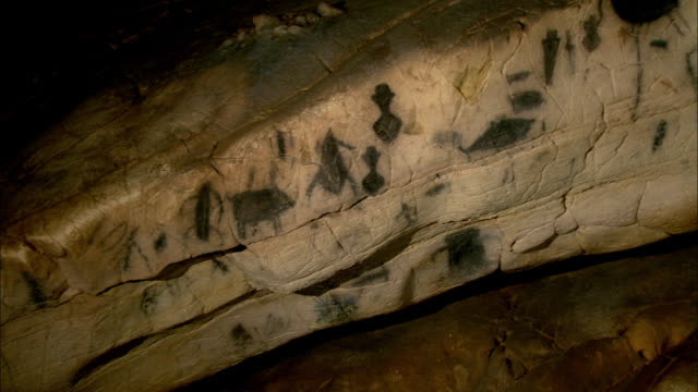 prehistoric mural inside a cave in levanzo island, west of sicily, italy - sicily stock videos & royalty-free footage