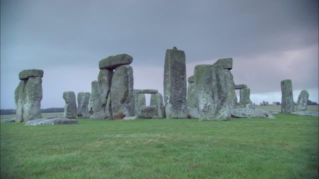 prehistoric stonehenge towers over england's salisbury plain. - obelisk stock videos & royalty-free footage