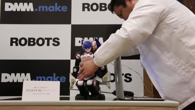 a premaid ai robot stands on display during a demonstration at an event hosted by dmm com ltd in tokyo japan on tuesday jan 27 2015 medium shot a... - 商品点の映像素材/bロール