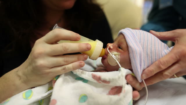 premature baby - feeding stock videos & royalty-free footage