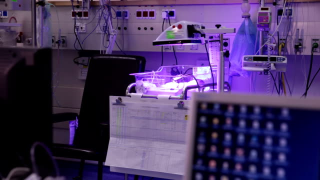 Premature infants in incubators under ultraviolet light