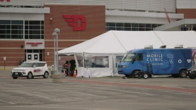 premier health in dayton, ohio begins testing individuals for covid-19 in drive-through tents set up in the parking lot of ud arena - dayton ohio stock videos & royalty-free footage