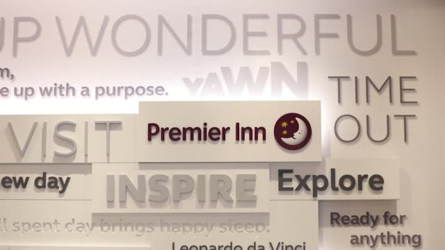 a premier inn sign hangs outside a premier inn hotel operated by whitbread plc in london uk on wednesday jan 17 a guest uses the self service checkin... - inn stock videos & royalty-free footage