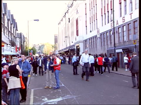 Arsenal and Manchester United draw ITN London Crowd gathering outside Highbury Stadium Supporters along