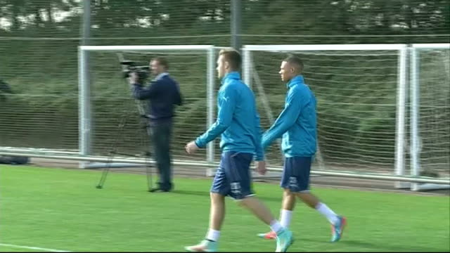 build up to chelsea v arsenal england hertfordshire london colney / surrey cobham arsenal and chelsea players running along during training... - cobham surrey stock videos and b-roll footage