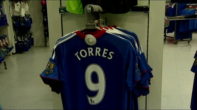 "chelsea fc sign fernando torres shirts on sale in chelsea megastore; england: london: stamford bridge: ext sign reading ""next home game chelsea v... - football strip stock videos & royalty-free footage"
