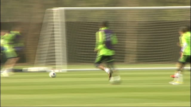 chelsea prepare to face wigan athletic surrey cobham ext ancelotti on training pitch chelsea players training - cobham surrey stock videos and b-roll footage