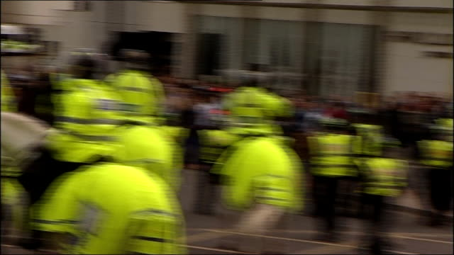 Fans clashing with police after match between Sunderland and Newcastle Fans shouting / mounted police in street / mounted police keeping fans back /...