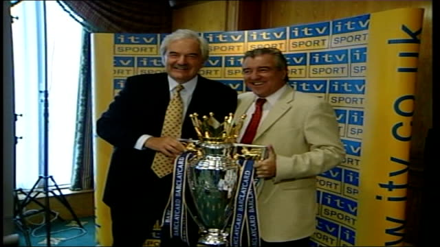 premier league football highlights move to photocall itn london des lynham at photocall posing with trophy / cs the barclaycard premiership trophy... - sports league stock videos & royalty-free footage