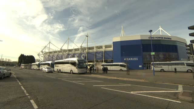 Leicester City fans Fans singing on coach Coaches outside the King Power Stadium and departing