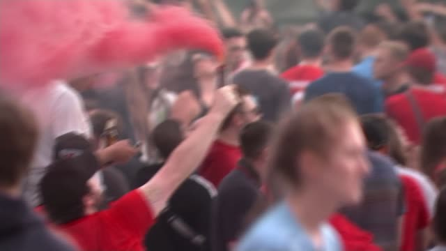 liverpool celebrate winning premier league; england: merseyside: liverpool: anfield: ext various of large crowd of liverpool football fans... - winning stock videos & royalty-free footage