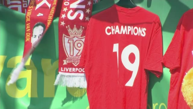 liverpool hoping to end 30-year title wait; england: merseyside: liverpool: ext gv anfield stadium george sephton interview sot liverpool fc scarves... - itvイブニングニュース点の映像素材/bロール