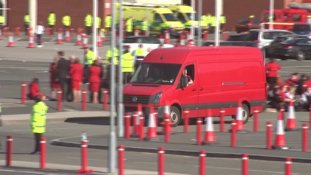 manchester united bus leaving stadium; england: manchester: old trafford ext general views of team bus departing stadium / fire engines arriving at... - gesamtansicht stock-videos und b-roll-filmmaterial